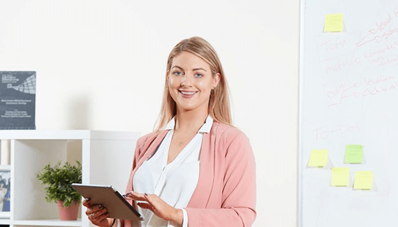 Young woman with a tablet device in an office