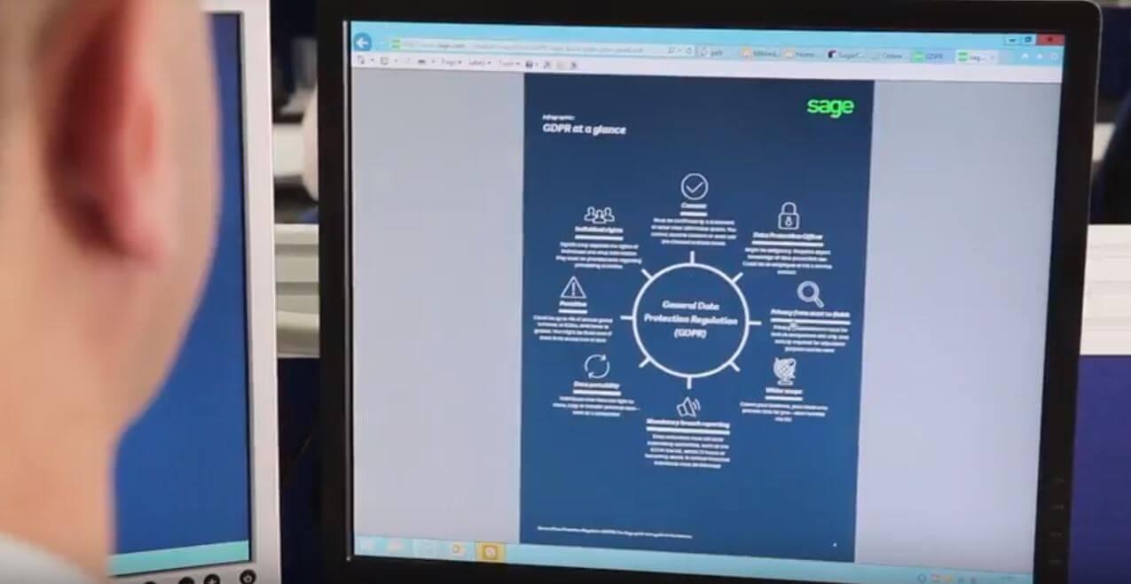 man looks at a GDPR factsheet on his computer screen