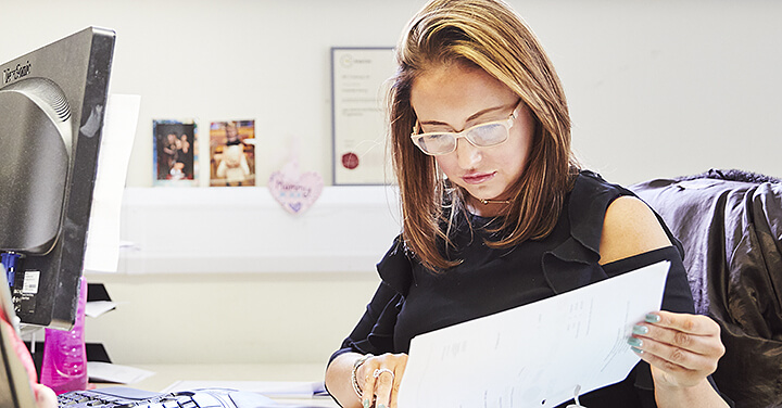 photo of women looking at documents in office