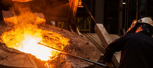 Man working with molten metal