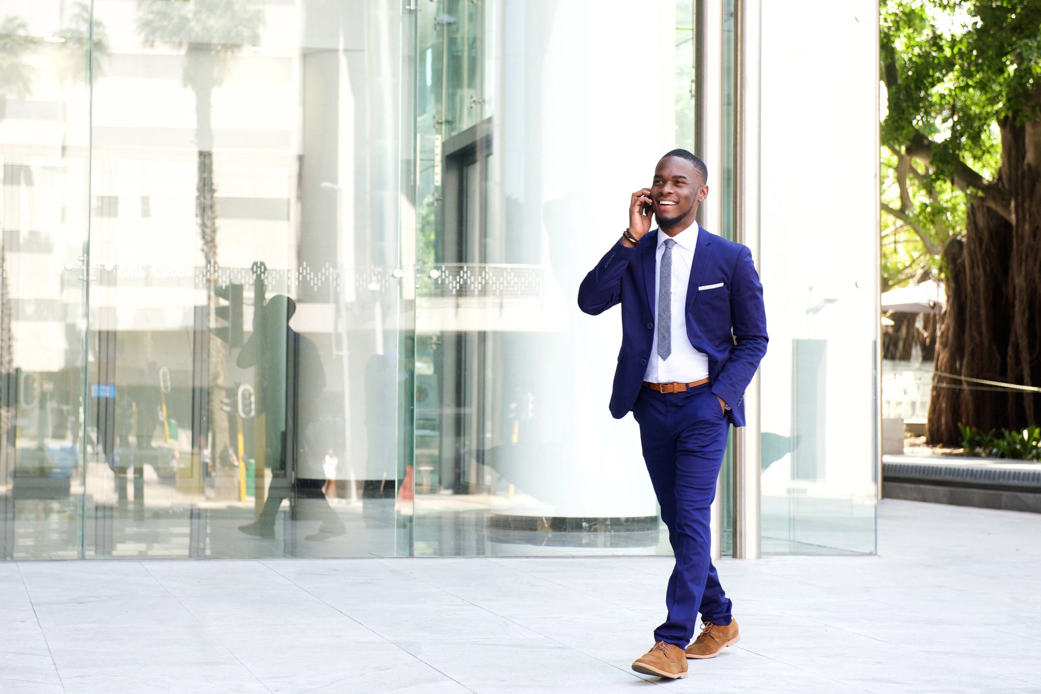 Business man on mobile phone outside office building