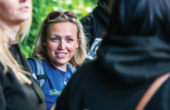 Sage Foundation Impact Report 2018: photo of smiling woman Sage Foundation volunteer at an event