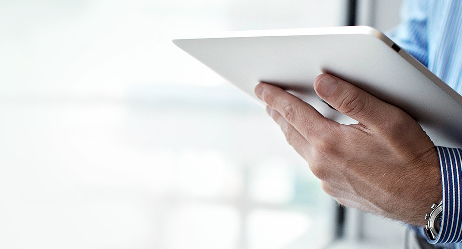 Image of man holding iPad