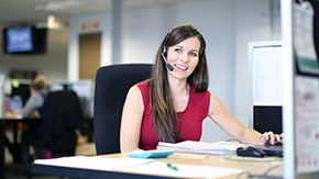 girl with headset at desk