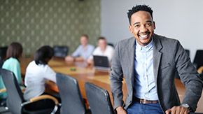 man smiling in boardroom