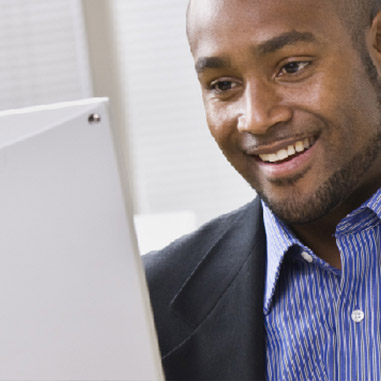 man smiling at screen