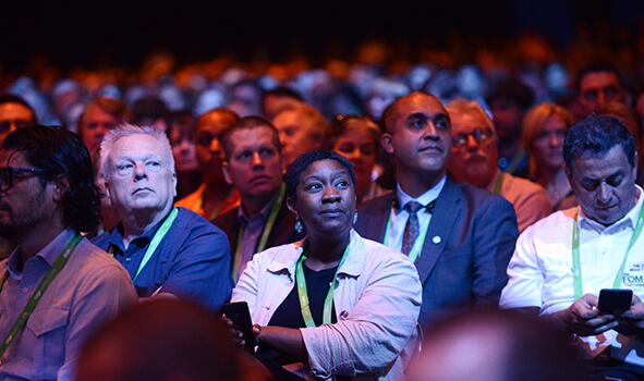 An audience of business leaders at a live event