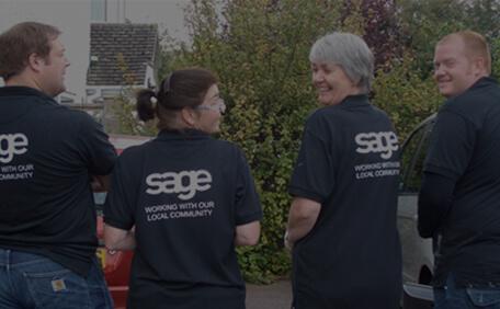 Group of Sage volunteers, men and women, from behind