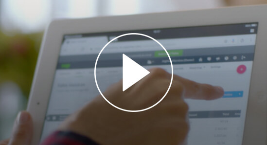 Screenshot from a video about payments featuring a person using a tablet