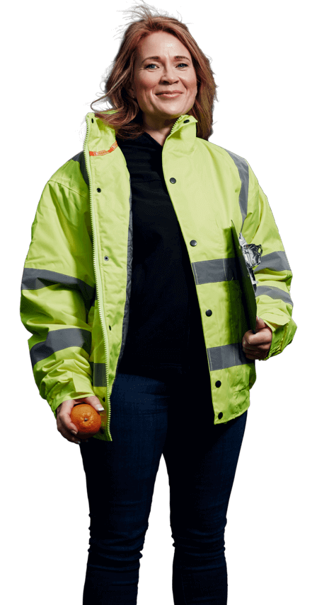 Woman with shoulder-length brown hair wearing a high-vis jacket holding a clipboard and an orange