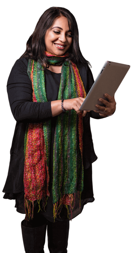 Woman with dark brown hair wearing a colourful scarf using a tablet