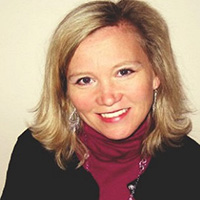 Kerstin Demko, Sage Partner Marketing Director, North America. OR Woman with shoulder-length blonde hair wearing a purple roll-neck and black blazer.