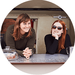 Roundel of two women working together in an independent coffee truck