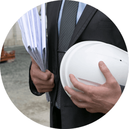 Roundel of a businessman holding documents and a hard hat