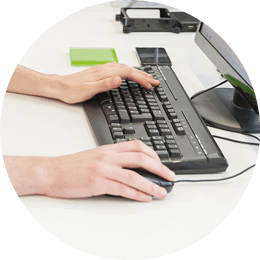 Roundel of hands typing on a black keyboard