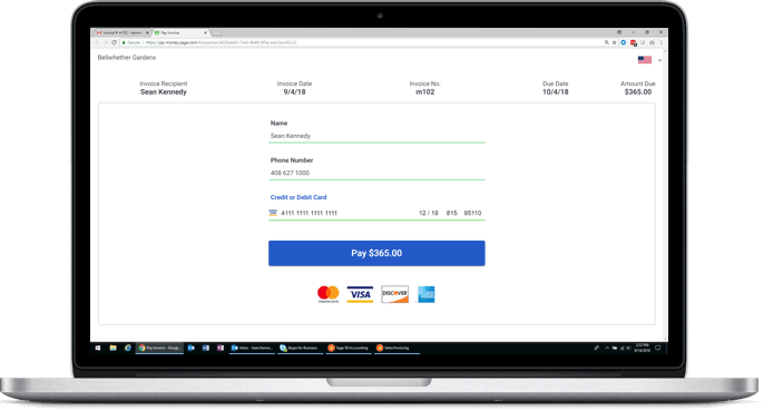 Laptop with a Sage Accounting platform customer invoice on the screen