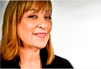 Smiling woman with light brown hair and bangs wearing red lipstick